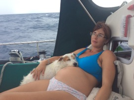 Jellybean being used as a pillow on the dreaded final sail to Antigua